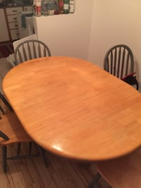 round brown wooden table with four chairs dining set Saint-Constant, J5A 1C4