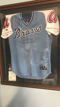 blue and white Atlanta Braves jersey shirt with brown wooden frame Jacksonville, 28546