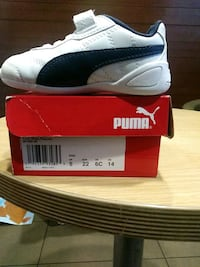 pair of white and black Puma low top sneakers Alexandria, 22306