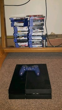 black Sony PS4 console with controller and game cases Toronto, M6K