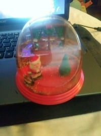 Santa Claus snow globe with a Christmas tree