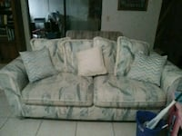 gray and white floral loveseat Tampa, 33625