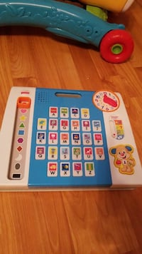 blue and white Fisher-Price alphabet toy