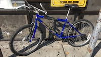 blue and white hardtail mountain bike