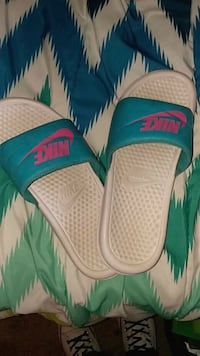 pair of white-and-teal Nike slide sandals Claremore, 74017