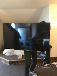 Black flat screen tv with remote Boulder, 80305