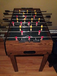 black and brown foosball table