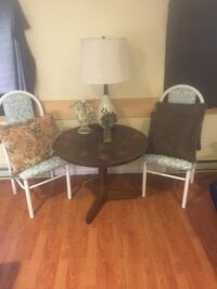 round brown wooden table with four chairs South Huron, N0M 1T0
