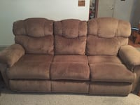 Lazy-boy brand chocolate brown reclining sofa and reclining love seat.