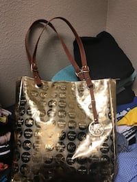 Brown and black leather tote bag Houston, 77077