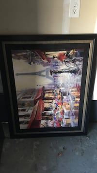 black wooden framed painting of Eiffel tower