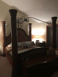 Brown wooden 4-poster bedroom set with king bed, two nightstands, armoire and two-tier dresser