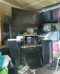 black flat screen TV with black wooden TV stand Bakersfield, 93313