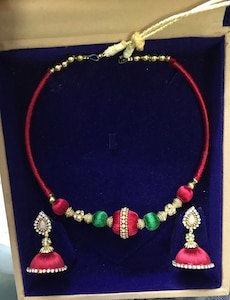 Red satin thread beaded necklace; pink satin thread beaded jhumka earrings