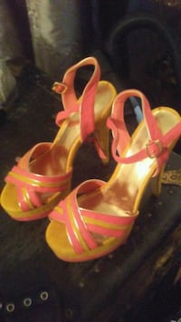pair of yellow leather open-toe ankle strap heels Calgary, T2K 3R8