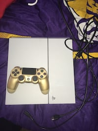 White sony playstation 4 with gold controller
