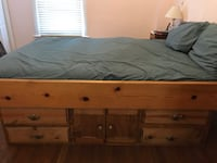 Queen waterbed with frame including storage underneath.  415 mi