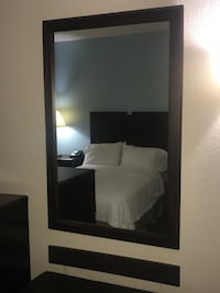 black wooden framed wall mirror null