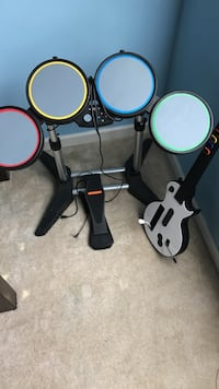 Black electric drum set and guitar game for wii