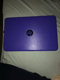 purple HP laptop with black corded mouse Riverdale, 93656