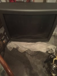 Black flat screen tv with remote Whitsett, 27377