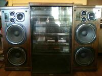 black stereo combo with pair of brown speakers