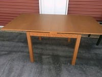 Wooden table extendable with 2 leaves London, N6B 0A1