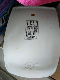 white George Foreman Lean Mean fat grilling machine