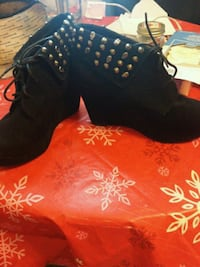 pair of black suede wedge booties 463 km