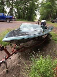 Panther - Blue powerboat on brown boat trailer Huntsville, P0A 1C0