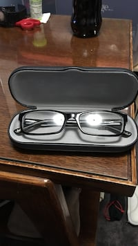 Black framed eyeglasses in case