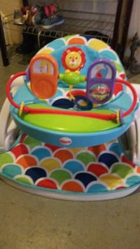 toddler's multicolored Fisher-Price sit-me-up floor seat