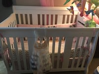 Baby's white wooden crib with bumper set Reston, 20191