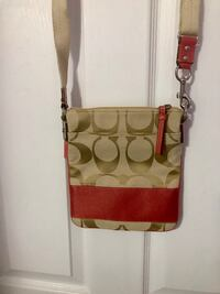 brown and pink Coach cross body new purse