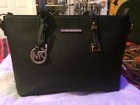 Micheal khors black purse Acworth, 30102