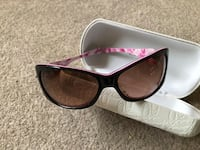 black framed sunglasses with case 11 km