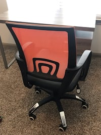 Black and orange rolling office chair Conroe, 77304