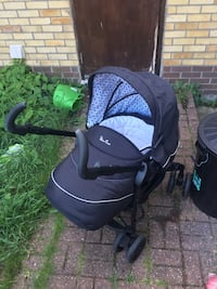 baby's black and white stroller with car seat Basildon, SS13 1NS