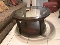 3 round brown woodenframed glass top table Tampa, 33605