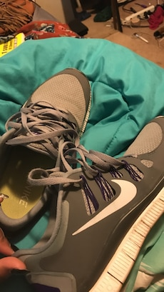 Gray-and-white Nike lace-up shoes