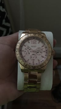 round white chronograph watch with gold link band Stratford, 06615