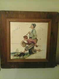 Man , boy fishing with a dog  wooden frame