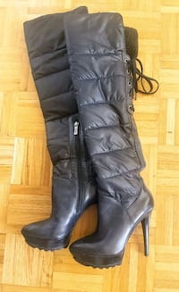 pair of black leather knee-high boots Mississauga, L4Y 3T7