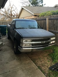 Black chevrolet single cab pick up truck