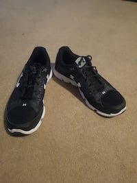 pair of black Under Armour running shoes Winnipeg