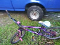 toddler's purple and white bicycle 645 mi