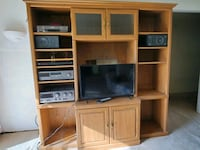 Nice wood TV stand with cabinets stereo DVD player speakers and TV