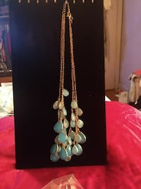 gold and teal charm necklace