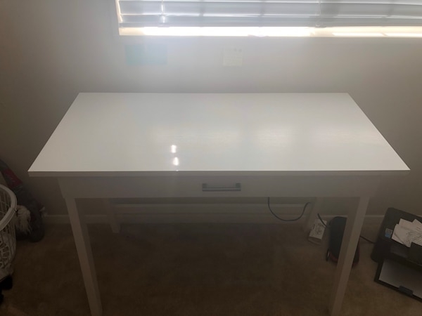 White desk with 1 large drawer, barely used, no damage. Originally bought it $125