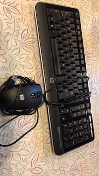black HP laptop with black corded mouse Cudahy, 53110